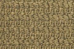 Le jaune a tricoté le fond de laine avec un modèle de tissu mou et laineux Texture de plan rapproché de textile d'or Images libres de droits