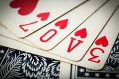Le jeu de carte de tisonnier s'chargent du texte d'amour Photo libre de droits