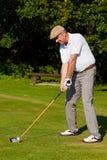Le jeu de l'â de golf a heurté la bille photo libre de droits