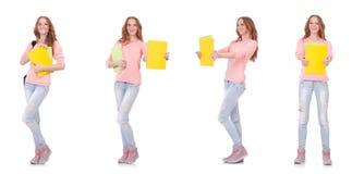 Le jeune étudiant avec des carnets d'isolement sur le blanc Photo stock