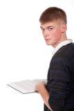 Le jeune étudiant avec le livre photo stock