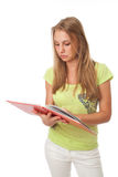 Le jeune étudiant avec le livre Image stock