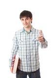 Le jeune étudiant d'isolement sur un blanc Image stock