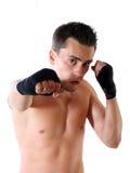Le jeune boxeur sur un fond blanc Photographie stock