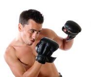 Le jeune boxeur sur un fond blanc Image libre de droits
