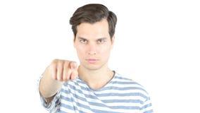 Le jeune casualman dirigeant son doigt à vous, commencent  image libre de droits