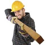 Le jeune charpentier a l'amusement au travail Photo stock