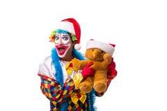 Le jeune comédien drôle de clown d'isolement sur le blanc images libres de droits