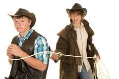 Le jeune cowboy ropes un autre cowboy Photos libres de droits