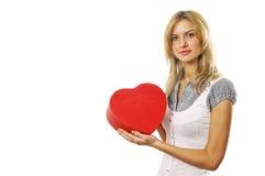 Le jeune femme avec un cadre de cadeau Photo stock