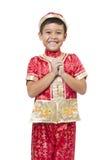 Le jeune garçon asiatique avec le cheongsam traditionnel chinois d'équipement ou se bronzent photo stock