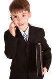 Le jeune garçon a mis en fonction en tant qu'homme d'affaires Photo stock