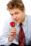 Le jeune homme avec s'est levé Image stock