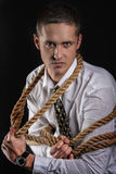 Homme d'affaires attaché avec la corde Photo libre de droits
