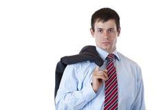 Le jeune homme d'affaires avec la jupe regarde sérieusement Image libre de droits