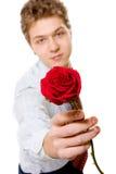 Le jeune homme d'affaires avec le rouge s'est levé Photo stock