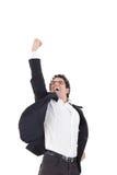 Le jeune homme d'affaires heureux saute dans le costume noir sur le blanc photos libres de droits