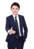 Le jeune homme d'affaires veulent avoir une secousse de main Photographie stock