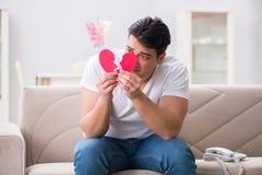 Le jeune homme dans le concept triste de valentine de saint Photographie stock