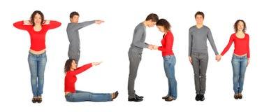 Le jeune homme et le femme effectuant le mot TEAM, collage photo stock