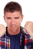 Le jeune homme frustrant affiche des poings Photos libres de droits