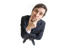Le jeune homme méfiant ou sceptique vous regarde Vue à partir de dessus D'isolement sur le fond blanc Photo stock