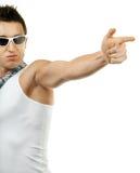 Le jeune homme musculaire tire le doigt images stock