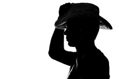 Le jeune homme tient la silhouette de chapeau de main Image stock