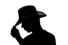 Le jeune homme tient la silhouette de chapeau de main Image libre de droits