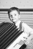 Le jeune joueur bayan. Photos stock
