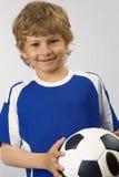 Le jeune joueur de football Photos stock