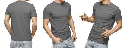 Le jeune mâle dans le T-shirt gris vide, avant et vue arrière, a isolé le fond blanc Concevez le calibre et la maquette de T-shir photo libre de droits
