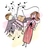 Le jeune pianiste et une femme chanteuse Photographie stock libre de droits