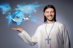 Le jeune prêtre chrétien dans le concept de transports aériens image stock