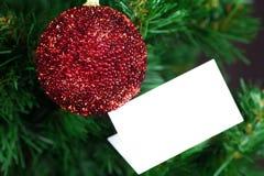 Le jouet et la carte de Noël vous remercient Photo stock