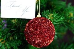 Le jouet et la carte de Noël vous remercient Image stock
