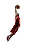 Le joueur de basket d'isolement dans l'action vole images stock
