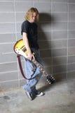 Le joueur de guitare de fil de sortie Photographie stock