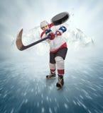 Le joueur de hockey donne le passage puissant photos libres de droits