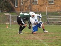 Le joueur de Lacrosse font face hors fonction Images stock
