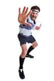 Le joueur de rugby a coupé sur le blanc photographie stock