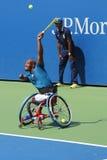 Le joueur de tennis Lucas Sithole d'Afrique du Sud pendant le quadruple 2014 de fauteuil roulant d'US Open choisit le match Photographie stock libre de droits