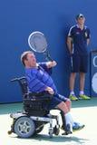 Le joueur de tennis Nicholas Taylor des Etats-Unis pendant le quadruple 2014 de fauteuil roulant d'US Open choisit le match photo stock