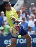 Le joueur de tennis professionnel Ivan Dodig pendant troisièmement le rond choisit le match à l'US Open 2013 photo libre de droits