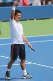 Le joueur de tennis professionnel Kei Nishikori célèbre la victoire après le premier US Open 2014 de rond Images libres de droits