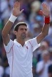 Le joueur de tennis professionnel Novak Djokovic célèbre la victoire après match de demi-finale à l'US Open 2013 Photo libre de droits