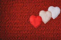 Le jour de valentines, rouge a tricoté le fond Photographie stock