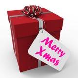 Le joyeux cadeau de Noël signifie des salutations de Noël heureux Photos libres de droits