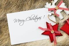 Le Joyeux Noël écrit souhaite la carte Photographie stock