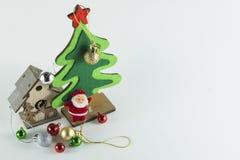 Le Joyeux Noël et la bonne année, arbre de Noël simulent sur le fond de petit morceau Images stock